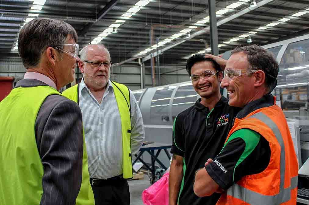 Congratulating management and staff at local manufacturer, Planex